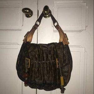 Louis Vuitton GM Monogram Kalahari Handbag Madonna